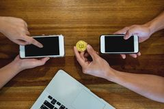 Hand exchange golden metal Bitcoin crypto currency investment- s stock photos
