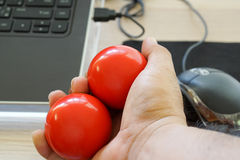 Hand exercise with balls. Hand holding balls for exercise to prevent or relief pain from arthritis Royalty Free Stock Images
