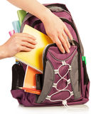 Hand with exercise book and bag Royalty Free Stock Photo