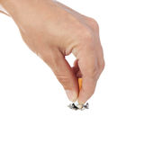 Hand extinguishes his cigarette. Stock Photo