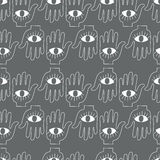 Hand with eye. Seamless background. Royalty Free Stock Photo