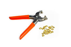 Hand Eyelet Tool and Metal eyelets Royalty Free Stock Images