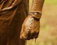 Hand för gyttjakörningsklocka royaltyfri foto