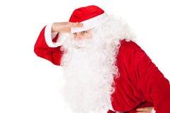 Hand för håll för Santa Claus look långväga på huvudet Royaltyfri Bild