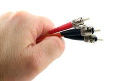 hand för kabeldatorfiber - som rymms optisk Fotografering för Bildbyråer