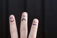 Hand för tre olik emoticons som dras på fingrar royaltyfri bild