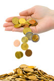 Hand and falling coins Stock Photography