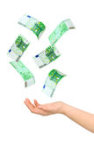 Hand and falling money. Isolated on white background Royalty Free Stock Photography