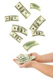 Hand and falling money Royalty Free Stock Photography