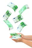 Hand and falling money. Isolated on white background Royalty Free Stock Image