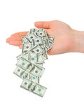 Hand and falling money Royalty Free Stock Images