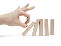 Hand and falling pieces Stock Photography