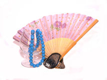 Hand fan, bracelet,  wineglass, and bead necklace Royalty Free Stock Images