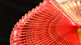 Hand fans decorated with flowers and made in wood rotating stock footage
