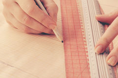 Hand fashion designer develops a sketch of the dress Royalty Free Stock Photography