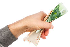 Hand fasst den Euro Stockfotos