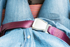 Hand fasten seat belt at seat on airplane before take off Royalty Free Stock Photography