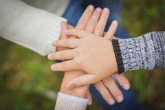 Hands folded on each other. The hand of father, mother and child lie on each other royalty free stock photos