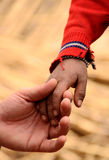 Hand of father and son. In south america, peru royalty free stock images