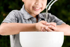Hand and faucet Stock Photography