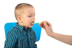 Hand feeding baby boy Stock Images