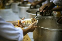Hand-feeding to the needy in society : concept of food sharing royalty free stock photography