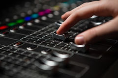 Hand of female audio engineer using sound mixer Stock Images