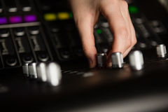 Hand of female audio engineer using sound mixer Stock Photo