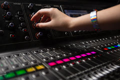 Hand of female audio engineer using sound mixer Royalty Free Stock Photography