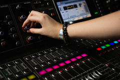 Hand of female audio engineer using sound mixer Royalty Free Stock Photos