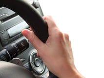 Hand female on a car wheel Royalty Free Stock Photo