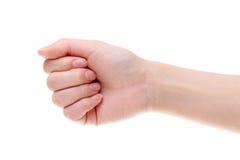Hand female fist closeup Stock Photos