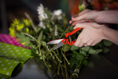 Hand of female florist preparing flower bouquet Royalty Free Stock Images