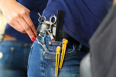 Hand of female hairdresser hold or pick scissors Royalty Free Stock Photos