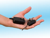 Hand female with the ignition key. The car ignition key in a hand Royalty Free Stock Image