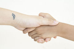 Hand of female with little tatoo at wrist Stock Photos