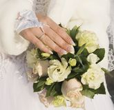 Hand of fiancee on a bouquet from roses Stock Image