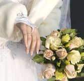 Hand of fiancee  a bouquet from roses Royalty Free Stock Images
