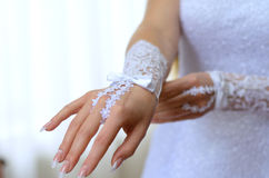 Hand of fiancee in a glove. Wedding-dress Royalty Free Stock Photography