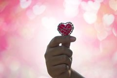 Hand is filing love lover  or give Valentines gift under warm li Stock Photography