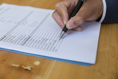 hand fill out reverse mortgage loan application on a clipboard. Stock Photography