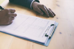 hand fill out reverse mortgage loan application on a clipboard. Stock Photos