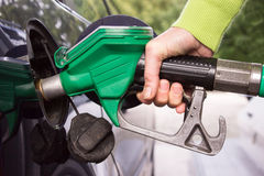Hand filling the car tank with gasoline Stock Image
