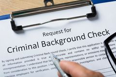 Free Hand Filling Criminal Background Check Application Form Royalty Free Stock Images - 124750349