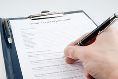 Hand filling in empty medical questionnaire Royalty Free Stock Photography