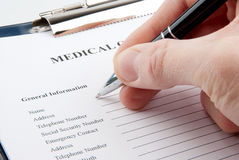 Hand filling in empty medical questionnaire Stock Photos