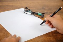 Hand filling in the form on a4 format vertical sheet Stock Image