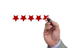 Hand filling out fifth star of performance rating Royalty Free Stock Photography
