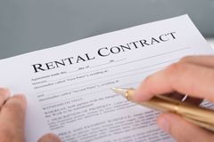 Hand filling rental contract Royalty Free Stock Images