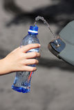Hand filling up water Royalty Free Stock Photos